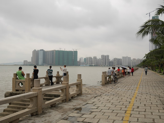 People look at Macau from Lovers' Lane in Zhuhai, China