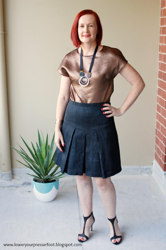 copper top and black pleated skirt