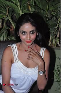 Actress Model Pooja Sri Stills in White Short Dress at F Club pre soft Launch  0080.JPG