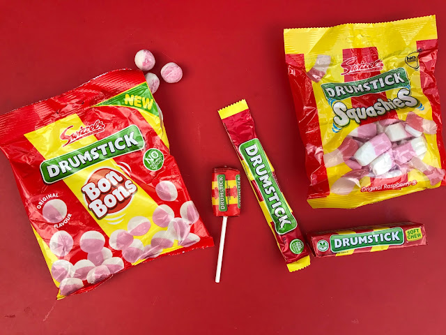 Several packets of Drumstick sweets including large bags of Bon Bons and Squashies, a drumstick lolly, a chew bar and a packet of soft chew sweets