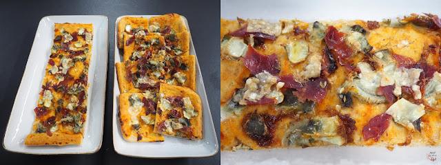 Pizza de masa casera con alcachofa al horno, jamón ibérico y parmesano, con aderezo de tomate, limón y ceps.