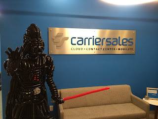 A life size Balloon Sculpture of Darth Vader next to the Carriersales sign