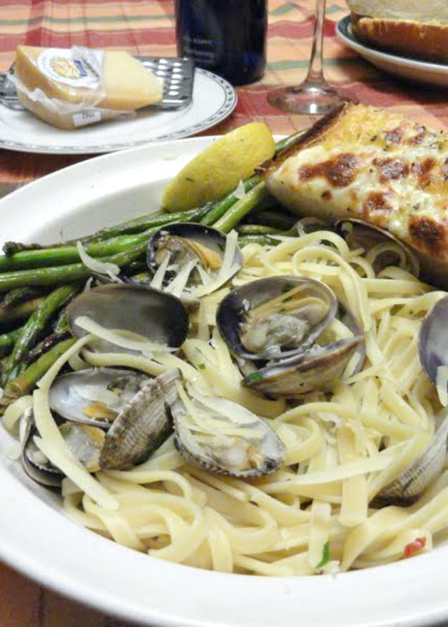 Clams with Linguine in a White Wine Butter Sauce recipe is an easy dinner favorite from Serena Bakes Simply From Scratch. A favorite way to slurp pasta!
