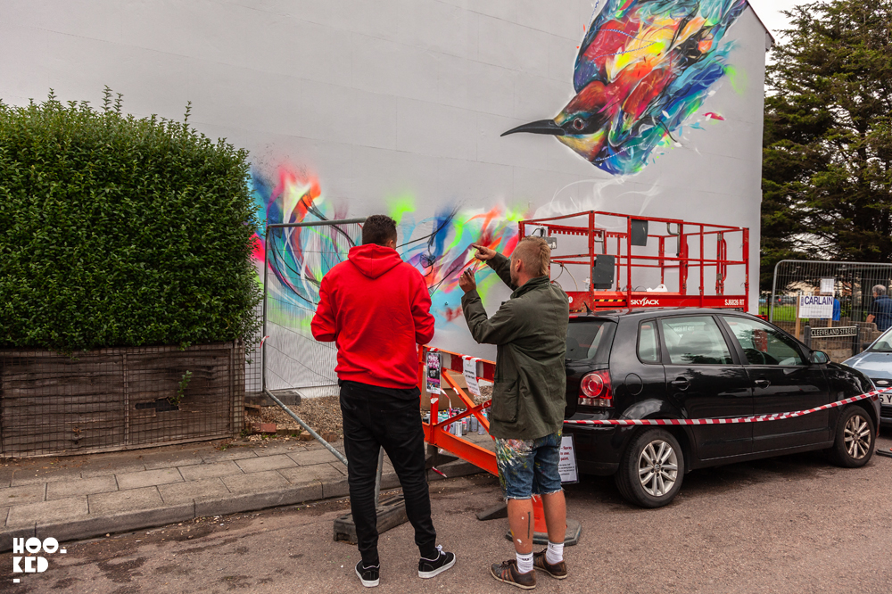Brazilian street artists L7M paints bird mural in Cheltenham