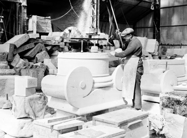 Easton, Bath and Portland Stone Firms, Ltd., Portland. Hand-carving in Portland Stone. Only straightforward work such as that on ashlar and on mouldings is carried out by machine. Finer work is all done by hand. Works of Bath and Portland Stone Firms, Ltd.