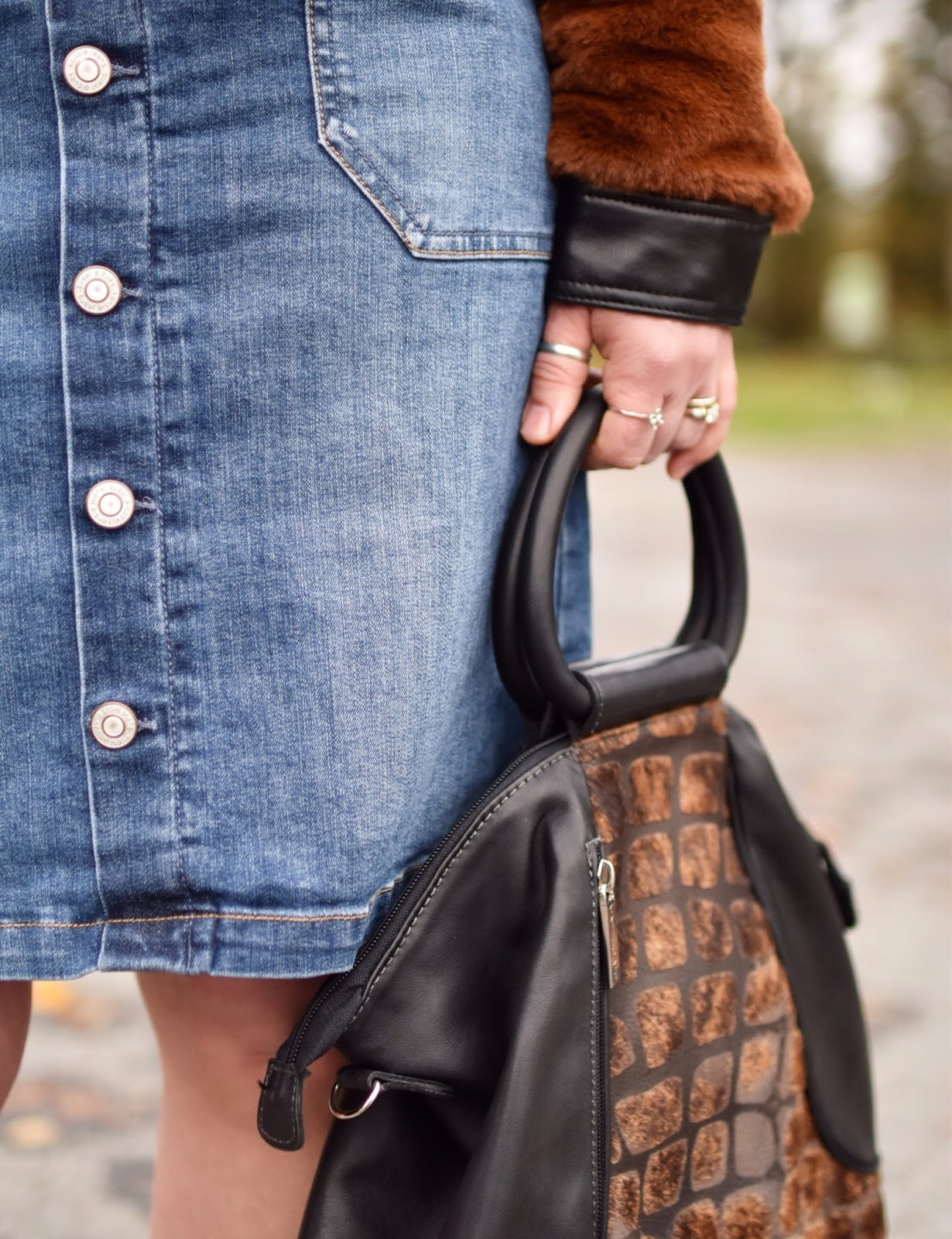 Monika Faulkner outfit inspiration - faux-fur bomber jacket, button-front denim skirt, Matteo Mio bag