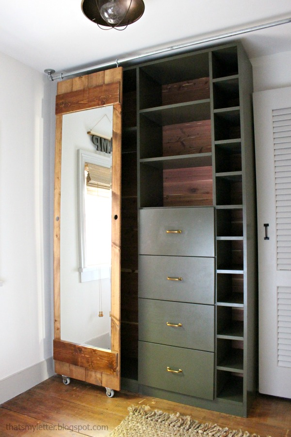 walk-in closet makeover with sliding mirror