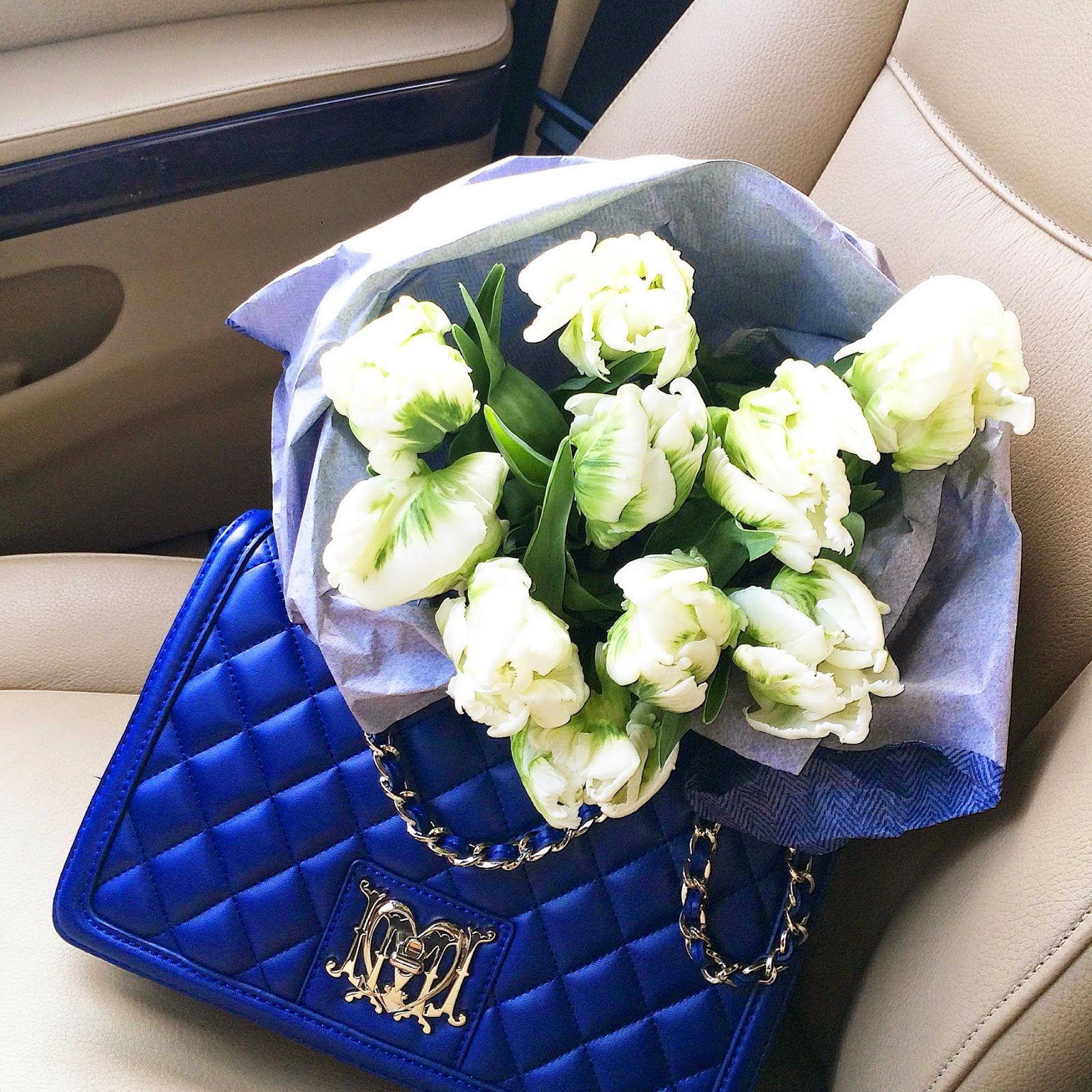 kristjaana mere instagram white tulips blue quilted bag