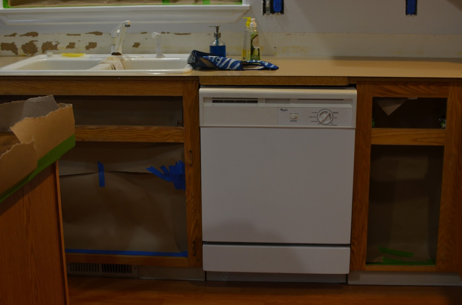 A two toned kitchen remodel with spray gun