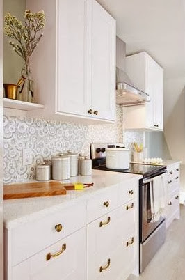 White kitchen after makeover with white counters and brass accents