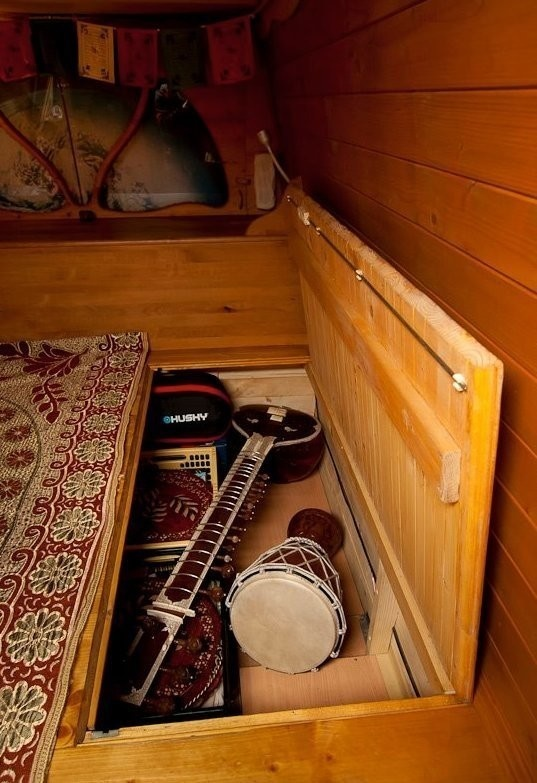 And underneath the floorboards there are more secret storage compartments. - Amazing Off-Grid Traveling Home Was Made Out Of An Old Van… Wait Till You See The Inside.