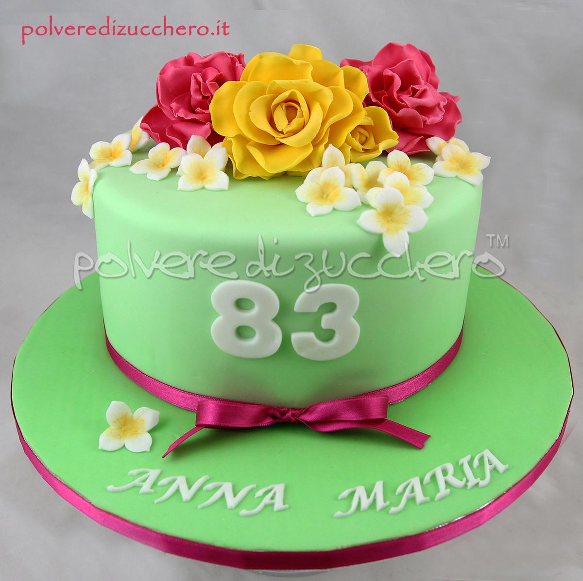 torta decorata cake design pasta di zucchero polvere di zucchero fiori di zucchero rose gialle rose fucsia