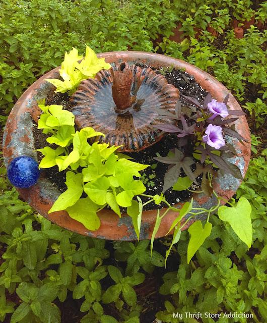 repurposed fountain garden planter