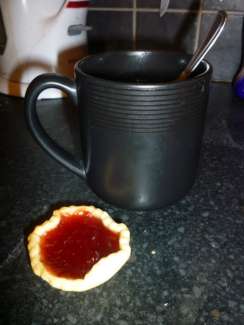 jam tart and hot drink