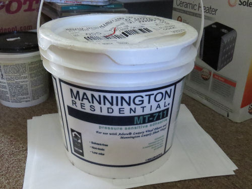 a bucket of Mannington Residential T-711 adhesive.