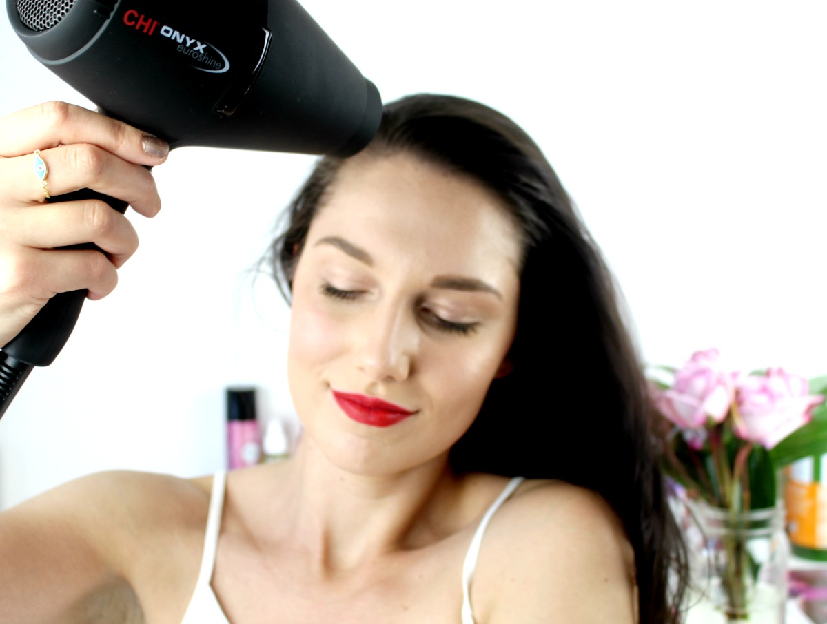 This is a shot of me blowing the hair away from my face with the Chi Onyx Blowdryer.