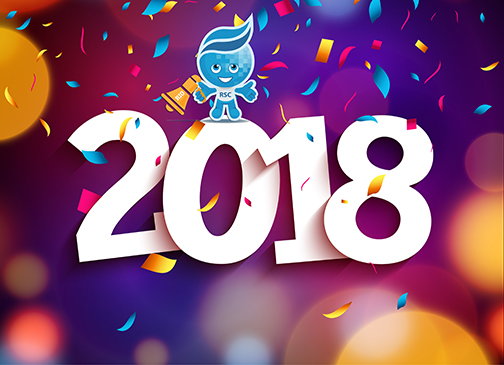 Image of confetti falling around 2018.  Rio mascot Splash sitting on top of the 2018 holding a megaphone