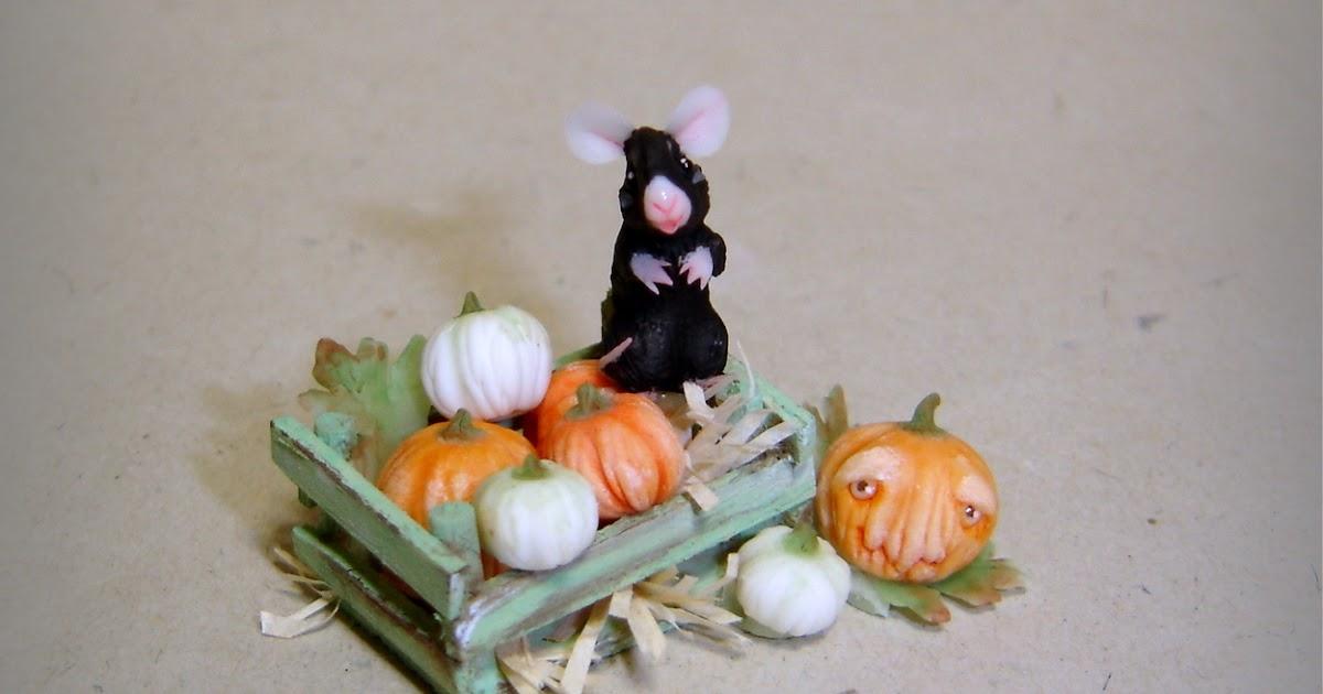Arriva l'autunno: il topino e le zucche