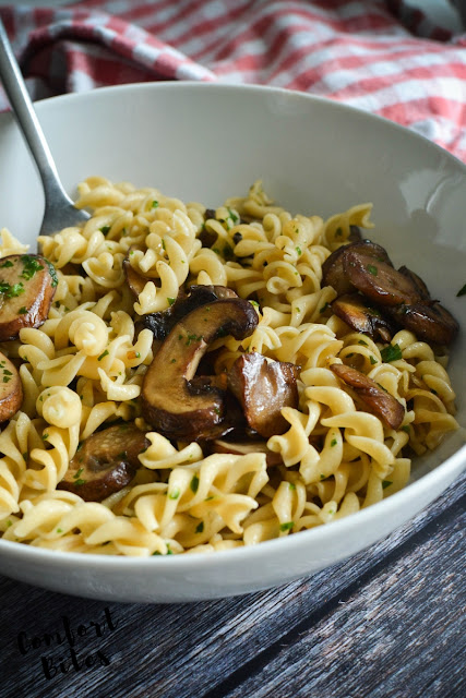 paleo grain free pasta in a bowl with garlic mushrooms and parsley