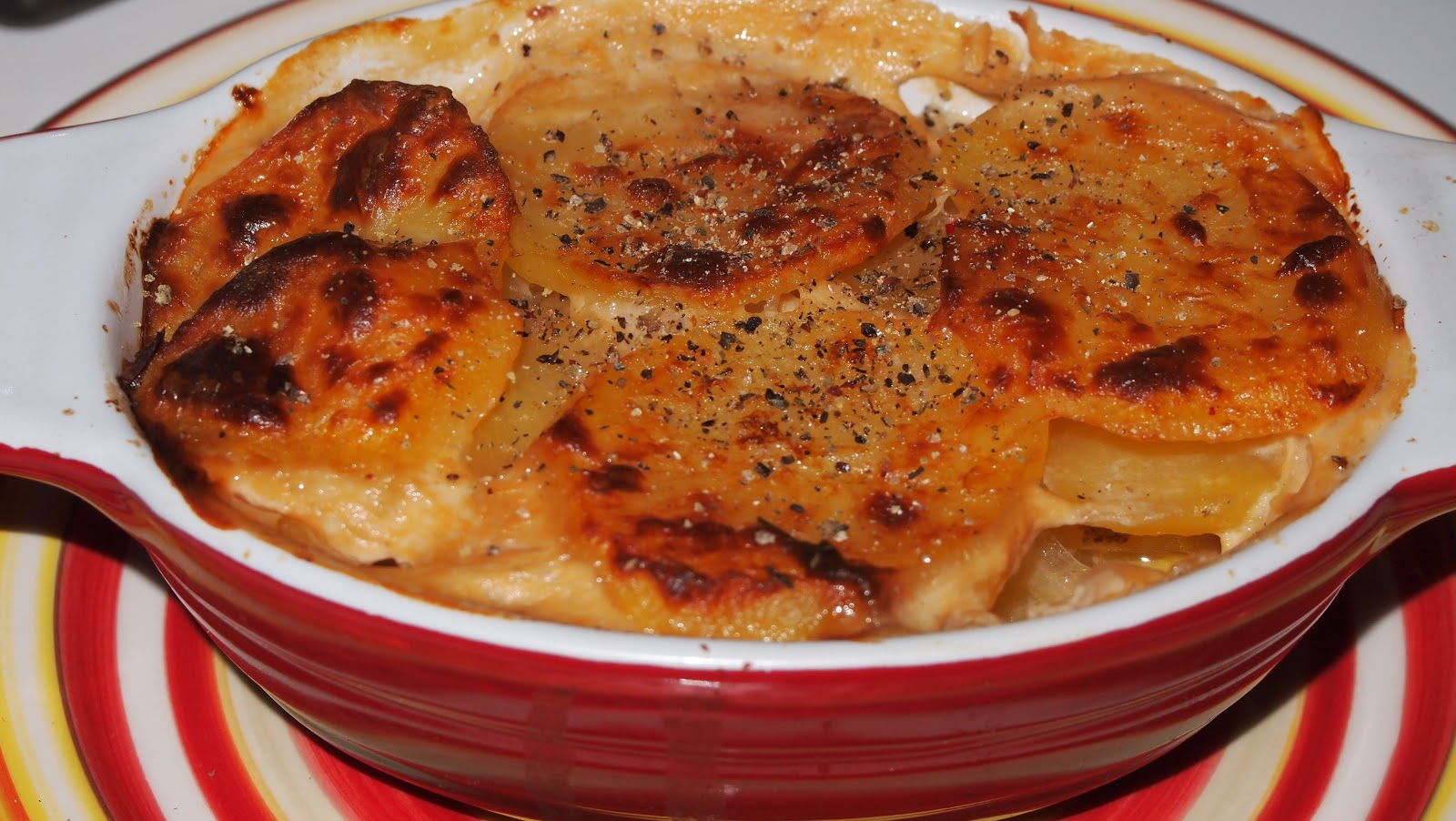 epicurious generations gratin dauphinois with caramelized onions. Black Bedroom Furniture Sets. Home Design Ideas