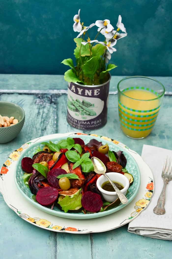 A substantial winter salad filled with roast vegetables on a bed of salad leaves, with sundried tomatoes, pickled beetroot, olives and a pesto balsamic dressing. Suitable for vegetarians and vegans.
