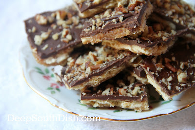 Saltine crackers, spread with a boiled brown sugar and butter sauce, then topped with chocolate, sometimes called Christmas Crack or Crack because they are downright addictive. Scatter some finely chopped nuts on top if you like!
