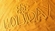 Picture of the word holiday drawn in a beach