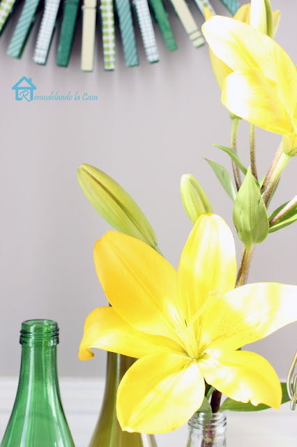 lilies, green bottles and wreath vignette for St. Patrick's day