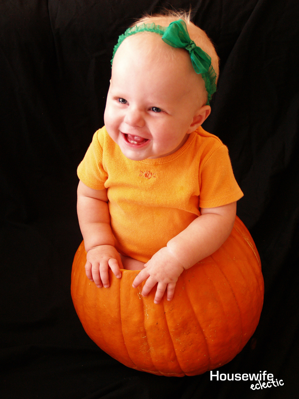 baby in a pumpkin photo to remember babys first halloween