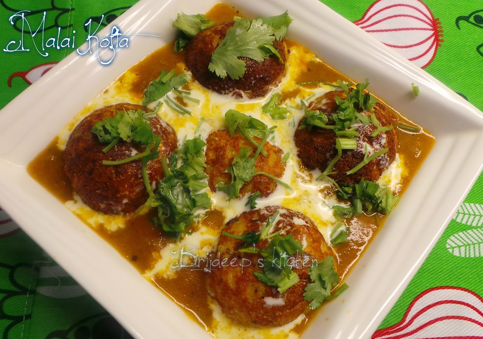 Effervescence malai kofta in appe pan if serving later warm the curry and koftas separately and serve hot you can even prepare and refrigerate the koftas a day before to add to the curry forumfinder Choice Image