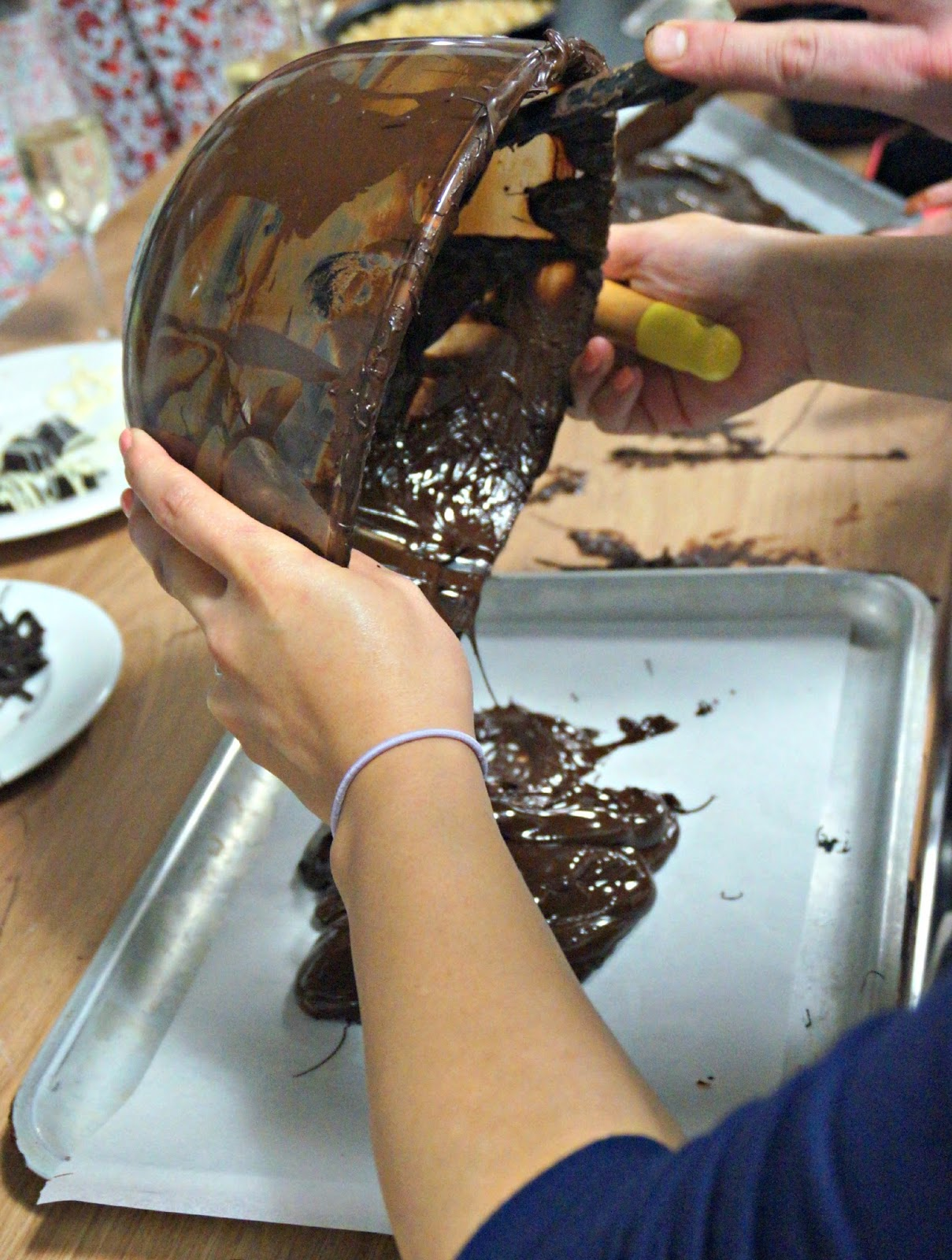 melted chocolate being put on tray