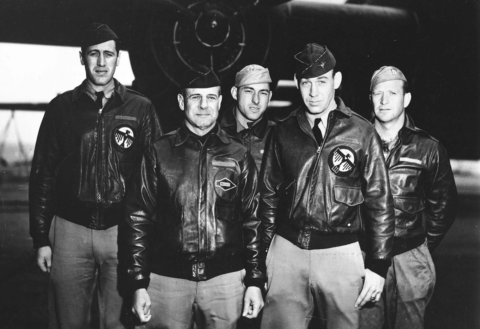 Posing in front of a bomber is Crew No. 1 of the Doolittle Raid, from the 34th Bombardment Squadron, Lt. Col. James H. Doolittle, pilot (2nd from left); Lt. Richard E. Cole, co-pilot; Lt. Henry A. Potter, navigator; SSgt. Fred A. Braemer, bombardier; SSgt. Paul J. Leonard, flight engineer/gunner.