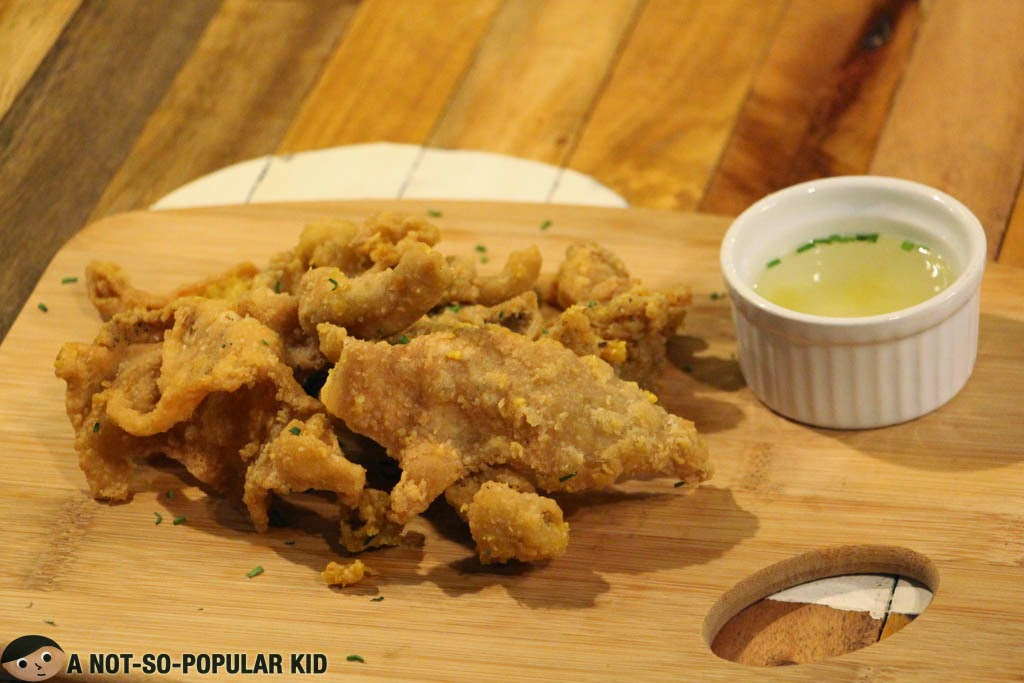 Salted egg chicken skin appetizer in the Backyard Restaurant