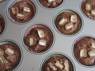 Food Lust People Love: Twix Muffins combine a sweet chocolate batter with crunchy Twix bars inside and on top for a batch of great snack muffins the whole family will love.