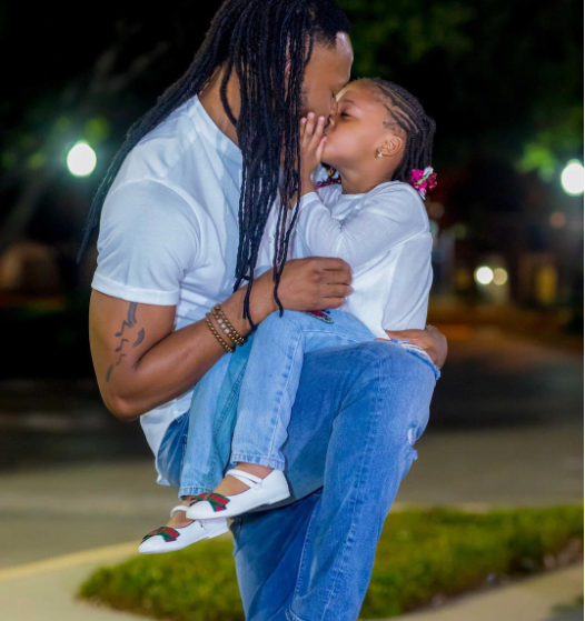 Internet trolls come after Flavour over kissing his 3-years old daughter.