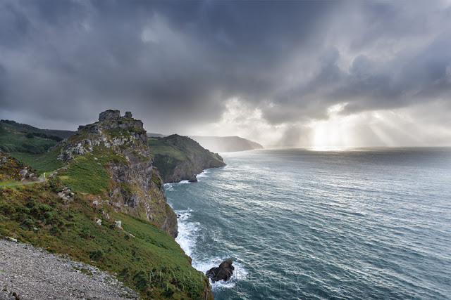 Stormy skies over Castle Rock at Valley of Rocks in Exmoor by Martyn Ferry Photography