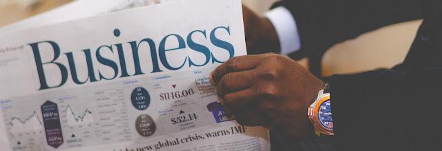 man reading a business newspaper