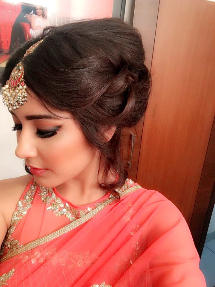 Rashi Khanna Beautiful Hair Style Photos In Orange Saree
