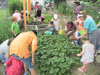 Children and adults working in garden