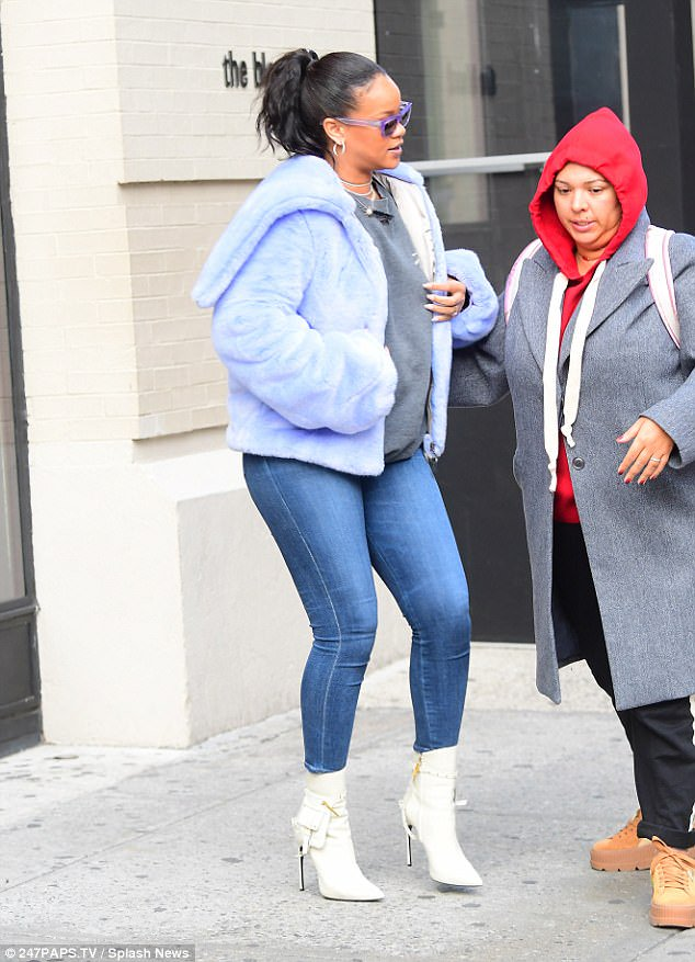 Rihanna display her curves in figure- hugging jeans as she steps out in NYC (See Photos)