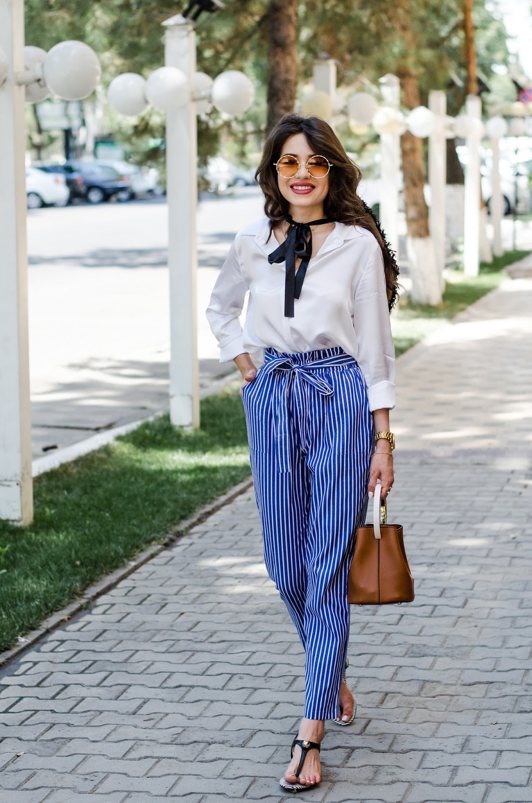 fashion blogger diyorasnotes diyora beta striped pants white shirt silk lilysilk oversized hat casual look outfitoftheday