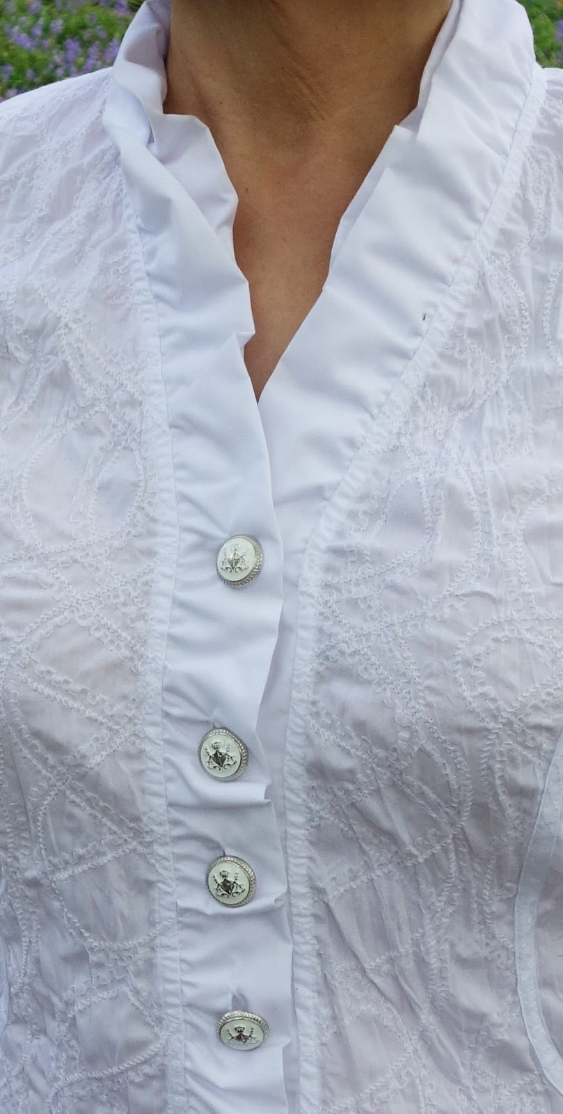 Close-up of button detail on white Peter Hahn blouse