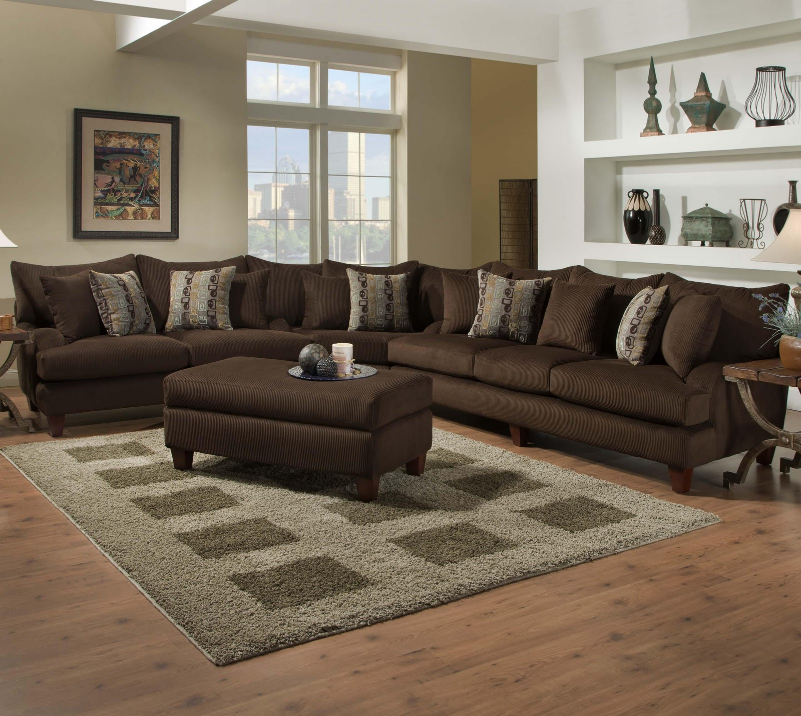 This modern collection of upholstery features a sofa loveseat chair not shown ottoman and sectional wrapped in a rich trackstar chocolate fabric
