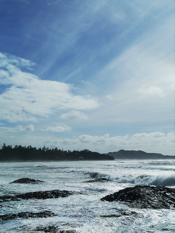 Waves breaking on black rocks at Chesterman Beach in Tofino, BC