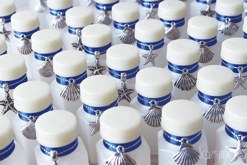 pomperos personalizados boda playa mar