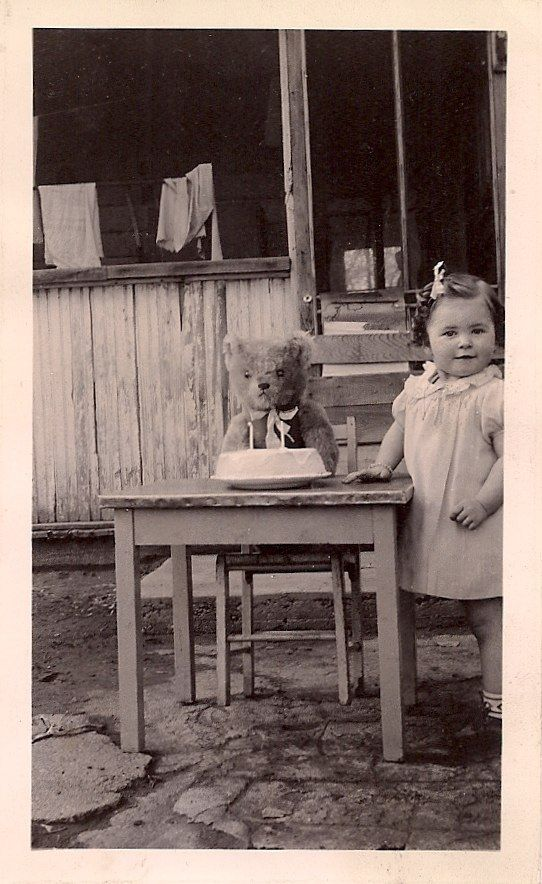 - Vintage Photo. Cute little girl celebrates her Teddy Bear's birthday. Burn at Both Ends. MarchMatron.com