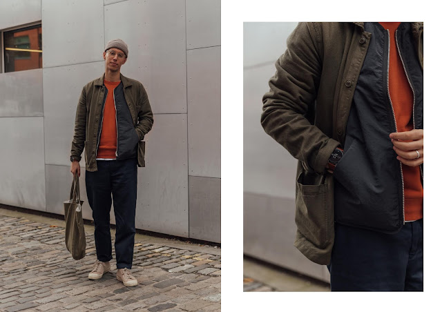 street style photo wearing orange ymc sweatshirt with arket gilet, a days march chore jacket and skagen falster 2 smartwatch