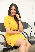 Actress Poojitha Stills in Yellow Short Dress at Darshakudu Movie Teaser Launch .COM 0276.JPG