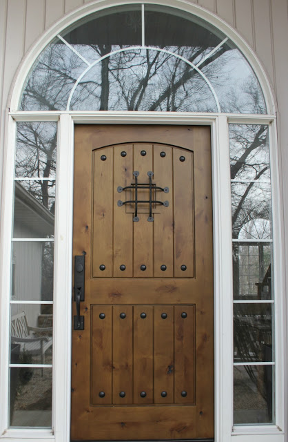 Rustic alder wood exterior door with speakeasy and handleset by Pacific Entries