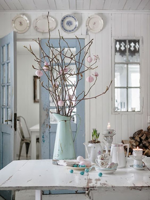 Blue and white farmhouse kitchen with farm table and shiplap